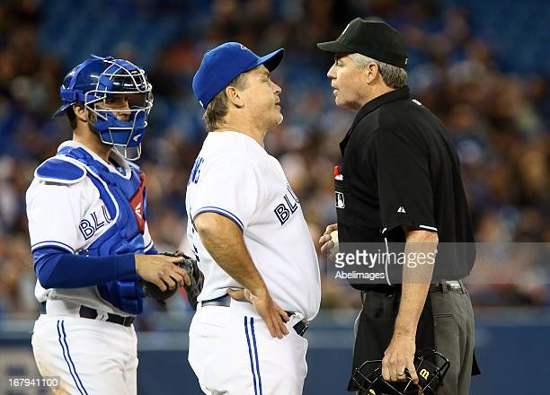 Manager John Gibbons of the Toronto Blue Jays argues a call at first base with official Gary Darling during action against the Boston Red Sox at the...