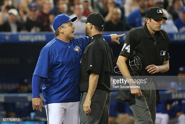 Manager John Gibbons of the Toronto Blue Jays argues a call with home plate umpire John Tumpane who walks away as second base umpire Dan Iassogna...