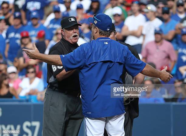 Manager John Gibbons of the Toronto Blue Jays argues with first base umpire Jim Joyce before being ejected in the ninth inning during MLB game action...