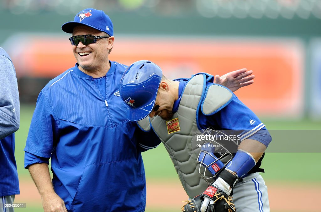 Manager John Gibbons #5 of the Toronto Blue Jays celebrates with Russell Martin #55 after a 3-1 victory against the Baltimore Orioles at Oriole Park at Camden Yards on May 21, 2017 in Baltimore, Maryland.