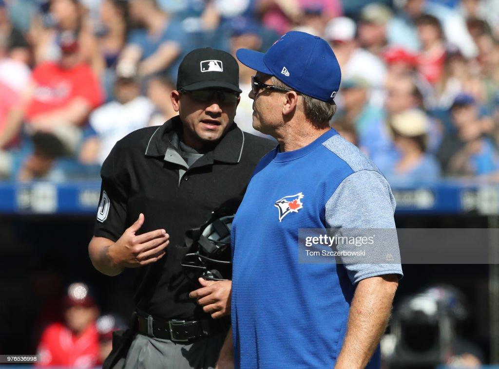 Manager John Gibbons #5 of the Toronto Blue Jays comes out of the dugout to argue a call with home plate umpire Roberto Ortiz #40 in the third inning during MLB game action against the Washington Nationals at Rogers Centre on June 16, 2018 in Toronto, Canada.
