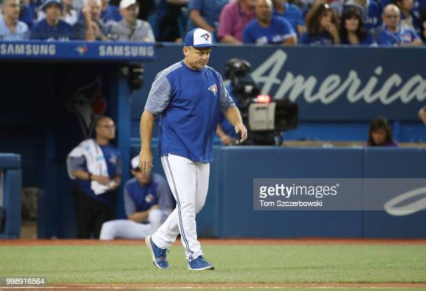Manager John Gibbons of the Toronto Blue Jays comes out of the dugout to make a pitching change in the fifth inning during MLB game action against...