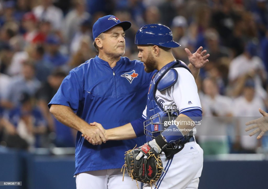 Manager John Gibbons #5 of the Toronto Blue Jays congratulates Russell Martin #55 after defeating the New York Yankees during MLB game action at Rogers Centre on August 10, 2017 in Toronto, Canada.