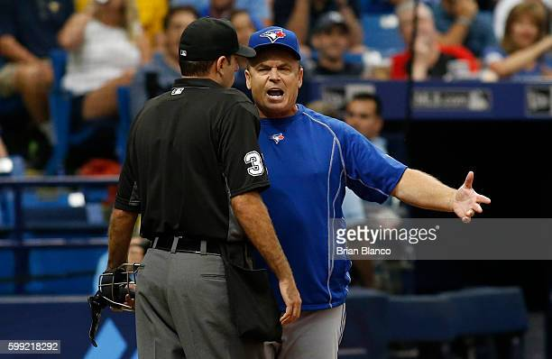 Manager John Gibbons of the Toronto Blue Jays has a discussion with home plate umpire Pat Hoberg after being ejected from the game by Hoberg during...