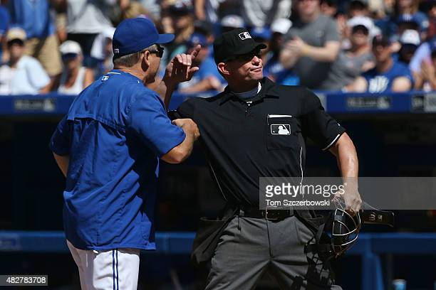 Manager John Gibbons of the Toronto Blue Jays is ejected by home plate umpire Jim Wolf in the seventh inning against the Kansas City Royals during...