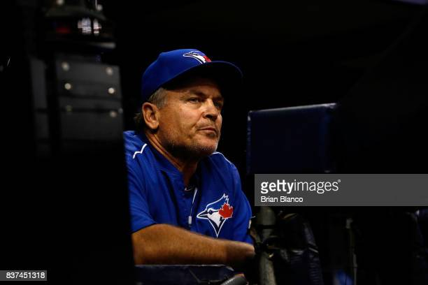 Manager John Gibbons of the Toronto Blue Jays looks on from the dugout during the third inning of a game against the Tampa Bay Rays on August 22 2017...