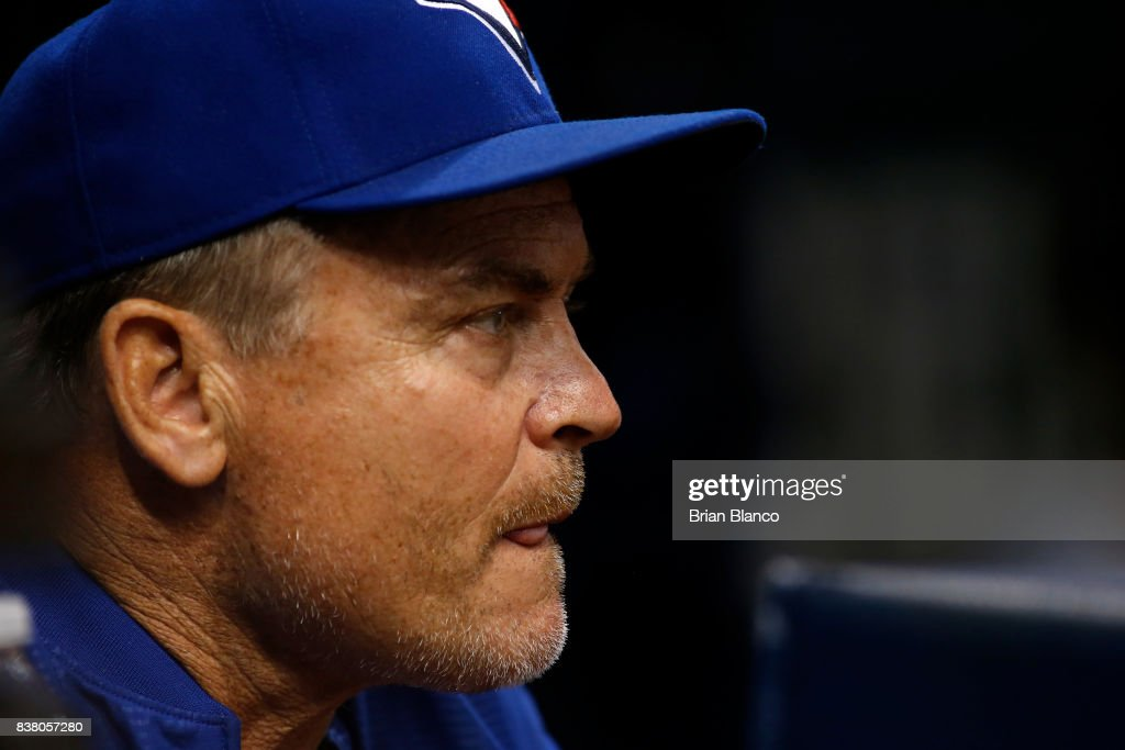 Manager John Gibbons #5 of the Toronto Blue Jays looks on from the dugout during the first inning of a game against the Tampa Bay Rays on August 23, 2017 at Tropicana Field in St. Petersburg, Florida.