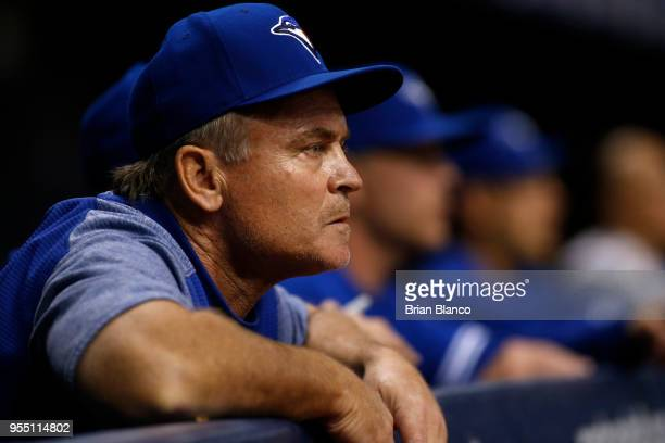 Manager John Gibbons of the Toronto Blue Jays looks on from the dugout during the fourth inning of a game against the Tampa Bay Rays on May 5 2018 at...