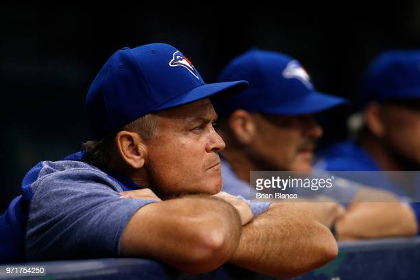 Manager John Gibbons of the Toronto Blue Jays looks on from the dugout during the third inning of a game against the Tampa Bay Rays on June 11 2018...