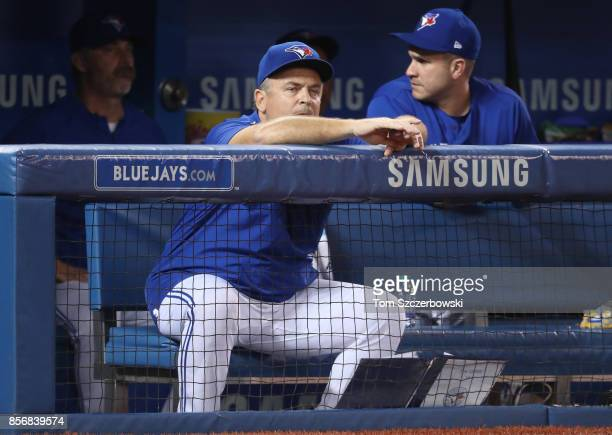 Manager John Gibbons of the Toronto Blue Jays looks on from the top step of the dugout during MLB game action against the Kansas City Royals at...