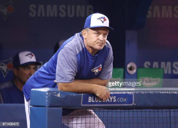 Manager John Gibbons of the Toronto Blue Jays looks on from the top step of the dugout during MLB game action against the Baltimore Orioles at Rogers...