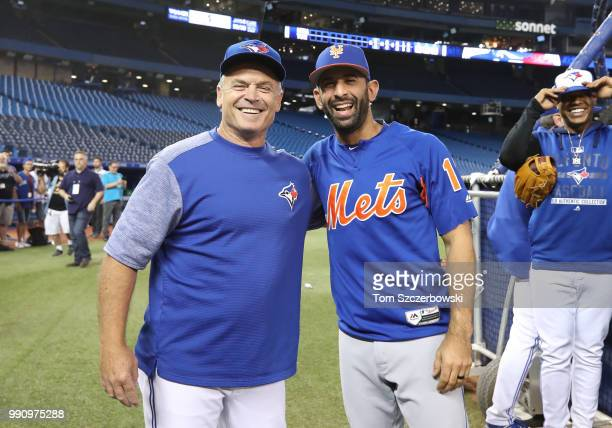 Manager John Gibbons of the Toronto Blue Jays meets with former Blue Jays player Jose Bautista of the New York Mets before the start of MLB game...
