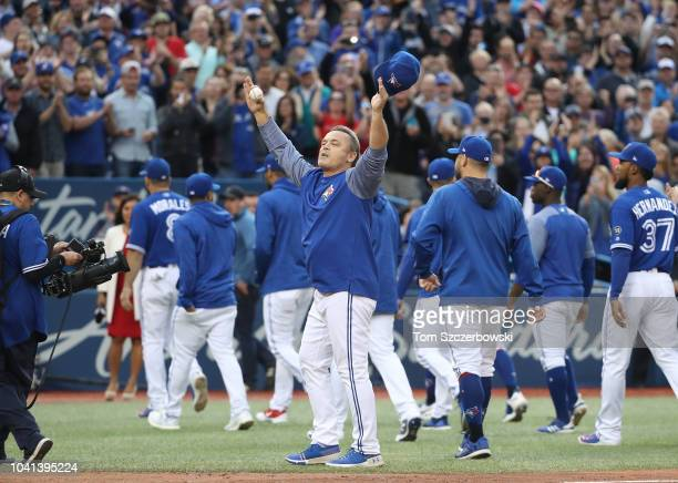 Manager John Gibbons of the Toronto Blue Jays salutes the fans after their victory and his final home game as manager after their MLB game against...