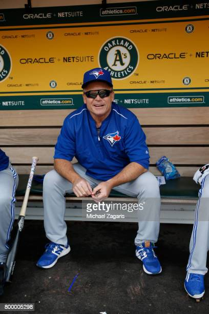 Manager John Gibbons of the Toronto Blue Jays sits in the dugout prior to the game against the Oakland Athletics at the Oakland Alameda Coliseum on...