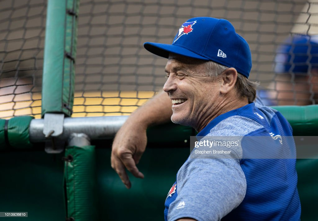 Manager John Gibbons of the Toronto Blue Jays smiles during batting practice before a game against the Seattle Mariners at Safeco Field on August 3, 2018 in Seattle, Washington. The Blue Jays won the game 7-2.