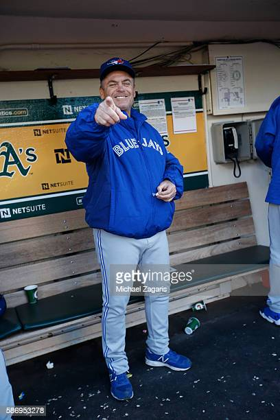 Manager John Gibbons of the Toronto Blue Jays stands in the dugout prior to the game against the Oakland Athletics at the Oakland Coliseum on July 15...