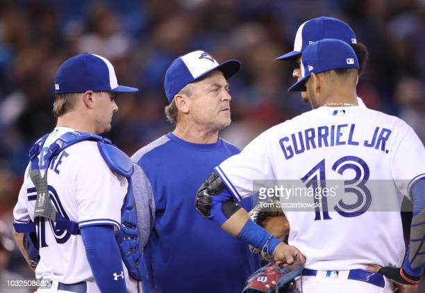 Manager John Gibbons of the Toronto Blue Jays talks to Jose Fernandez on the mound as Reese McGuire looks on in the fifth inning during MLB game...