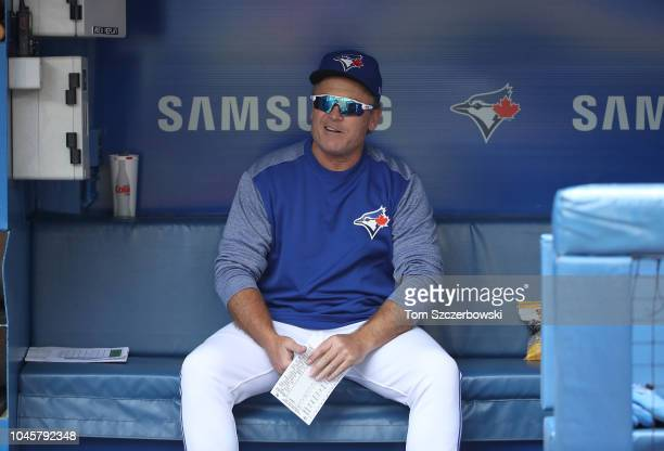 Manager John Gibbons of the Toronto Blue Jays waits in the dugout before delivering the lineup card to the umpires on his final home game as manager...