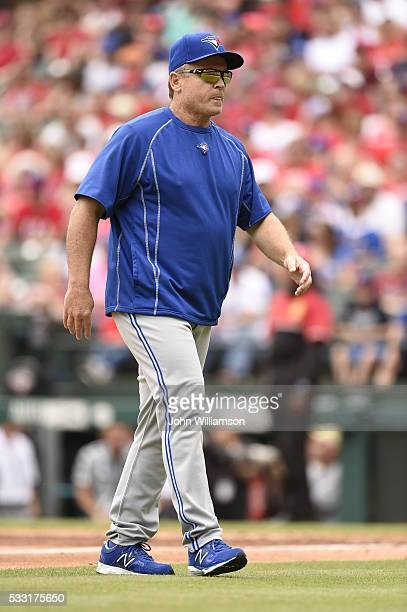 Manager John Gibbons of the Toronto Blue Jays walks back to the dugout after visiting the pitcher's mound in the game against the Texas Rangers at...