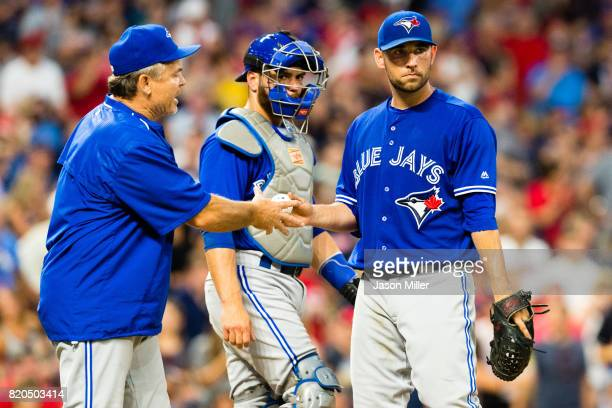 Manager John Gibbons removes starting pitcher Marco Estrada of the Toronto Blue Jays from the game during the fifth inning against the Cleveland...