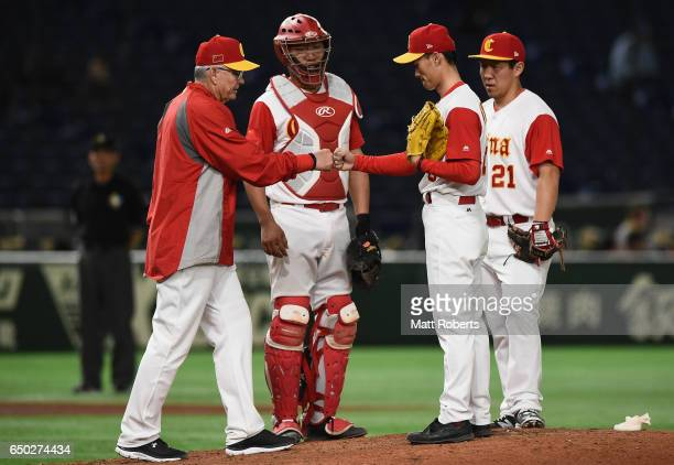Manager John McLaren of China calls a pitching change to Pitcher Yanyong Yang in the top of the seventh inning during the World Baseball Classic Pool...