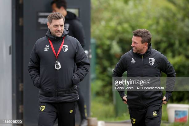 Manager Jonathan Woodgate with assistant Steve Purches of Bournemouth before a training session at the Vitality Stadium on May 20, 2021 in...