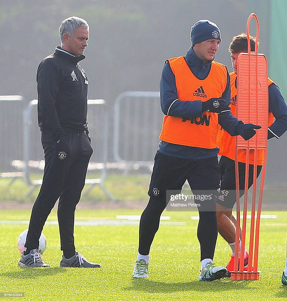 Manager Jose Mourinho and Bastian Schweinsteiger of Manchester United in action during a first team training session at Aon Training Complex on October 31, 2016 in Manchester, England.