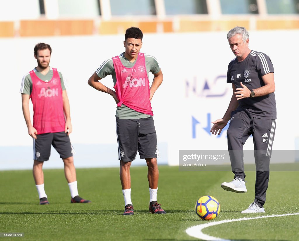 Manager Jose Mourinho and Jesse Lingard of Manchester United in action during a first team training session at Nad Al Sheba Sports Complex on January 10, 2018 in Dubai, United Arab Emirates.