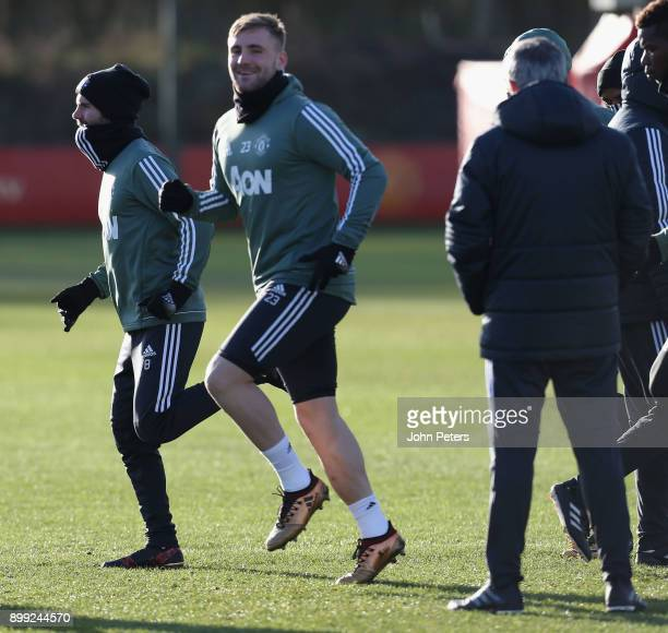 Manager Jose Mourinho and Luke Shaw of Manchester United in action during a first team training session at Aon Training Complex on December 28 2017...