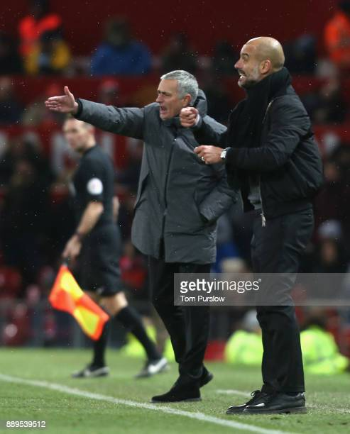 Manager Jose Mourinho and Manager Pep Guardiola of Manchester City watch from the touchline during the Premier League match between Manchester United...