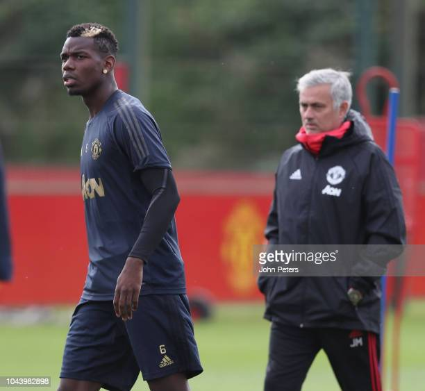 Manager Jose Mourinho and Paul Pogba of Manchester United in action during a first team training session at Aon Training Complex on October 1 2018 in...