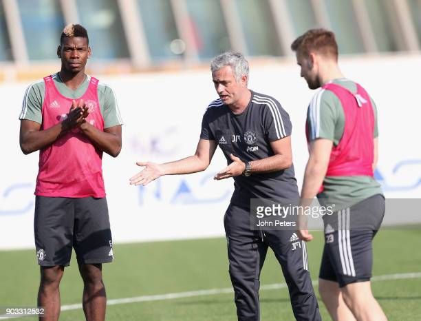 Manager Jose Mourinho and Paul Pogba of Manchester United in action during a first team training session at Nad Al Sheba Sports Complex on January 10...