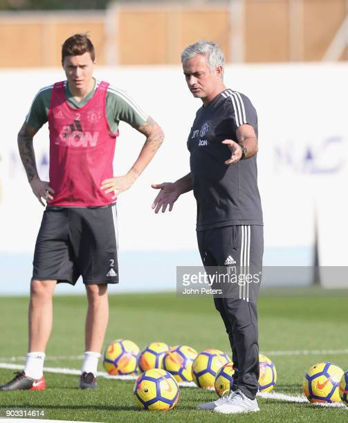 Manager Jose Mourinho and Victor Lindelof of Manchester United in action during a first team training session at Nad Al Sheba Sports Complex on...