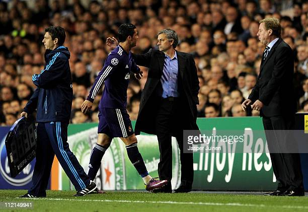 Manager Jose Mourinho congratulates Cristiano Ronaldo of Real Madrid as he leaves the pitch during the UEFA Champions League quarter final second leg...