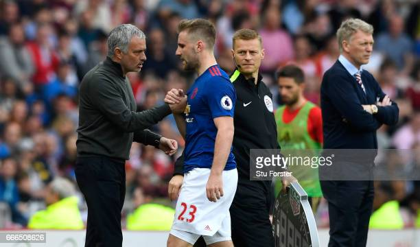 Manager Jose Mourinho congratulates Luke Shaw after being substituted during the Premier League match between Sunderland and Manchester United at...