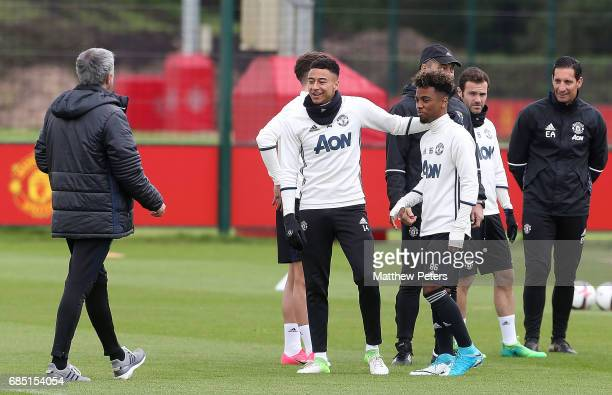 Manager Jose Mourinho, Jesse Lingard and Angel Gomes of Manchester United in action during a first team training session at Aon Training Complex on...