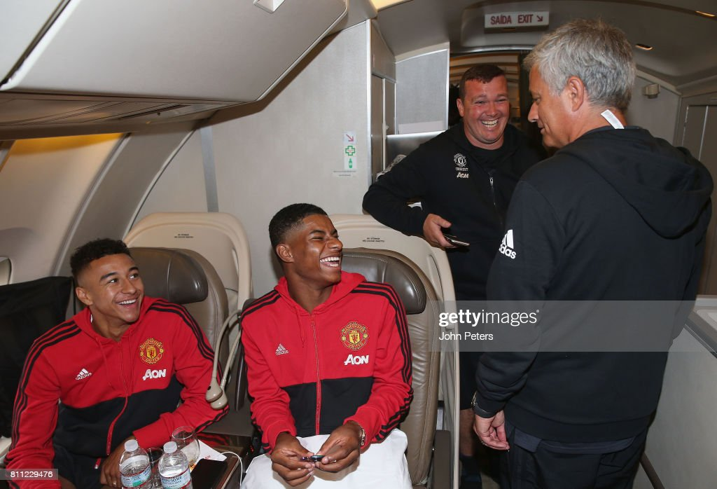Manager Jose Mourinho, Jesse Lingard and Marcus Rashford sit on the aeroplane ahead of the club's pre-season tour of the USA at Manchester Airport on July 9, 2017 in Manchester, England.
