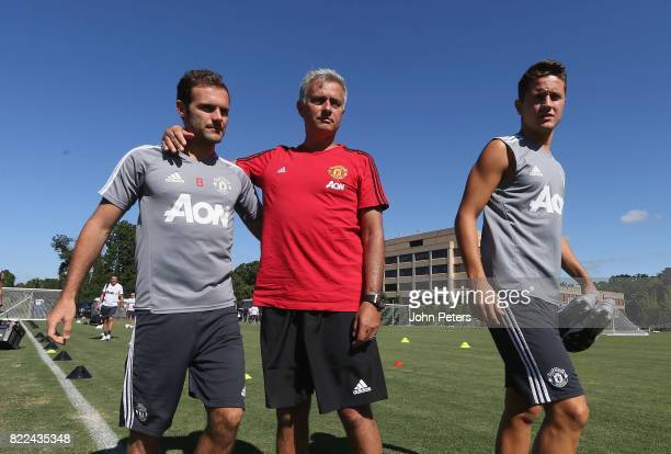 Manager Jose Mourinho Juan Mata and Ander Herrera of Manchester United in action during a first team training session as part of their preseason tour...