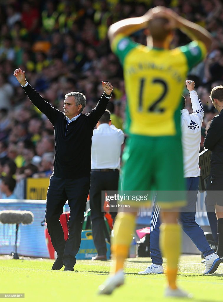 Manager Jose Mourinho of Chelsea celebrates after Eden Hazard of Chelsea (not pictured) scores their second goal during the Barclays Premier League match between Norwich City and Chelsea at Carrow Road on October 6, 2013 in Norwich, England.
