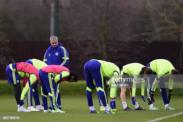 Manager Jose Mourinho of Chelsea looks on as his players warm up during a Chelsea press conference ahead of the UEFA Champions League Group G match...