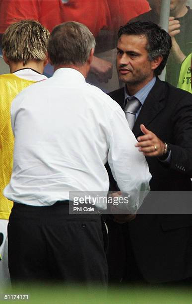 Manager Jose Mourinho of Chelsea shakes hands with Sir Alex Ferguson of Manchester United at the end during the Barclays Premiership match between...