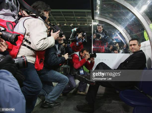 Manager Jose Mourinho of Chelsea sits on the bench as photographers mob him during the Champions League Group H match against FC Porto and Chelsea at...