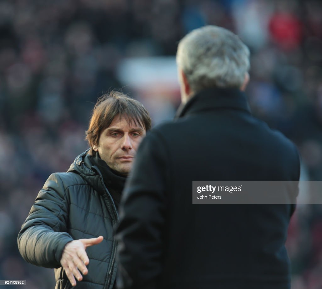 Manager Jose Mourinho of Manchester United and Manager Antonio Conte of Chelsea shake hands after the Premier League match between Manchester United and Chelsea at Old Trafford on February 25, 2018 in Manchester, England.