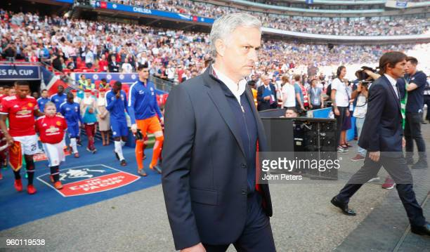 Manager Jose Mourinho of Manchester United and Manager Antonio Conte of Chelsea lead the teams out ahead of the Emirates FA Cup Final match between...