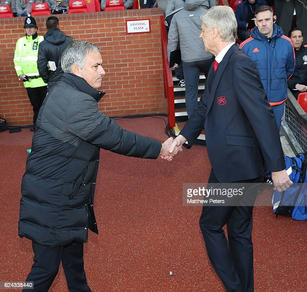 Manager Jose Mourinho of Manchester United and Manager Arsene Wenger of Arsenal shake hands ahead of the Premier League match between Manchester...