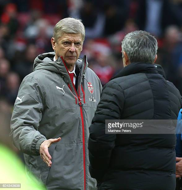 Manager Jose Mourinho of Manchester United and Manager Arsene Wenger of Arsenal shake hands after the Premier League match between Manchester United...