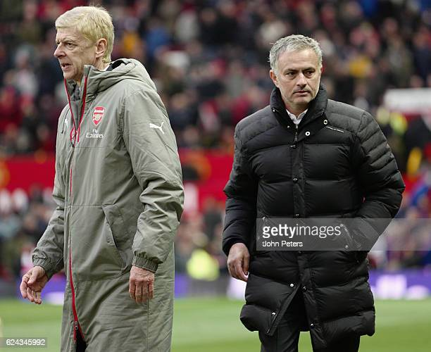 Manager Jose Mourinho of Manchester United and Manager Arsene Wenger of Arsenal shake hands after the touchline during the Premier League match...