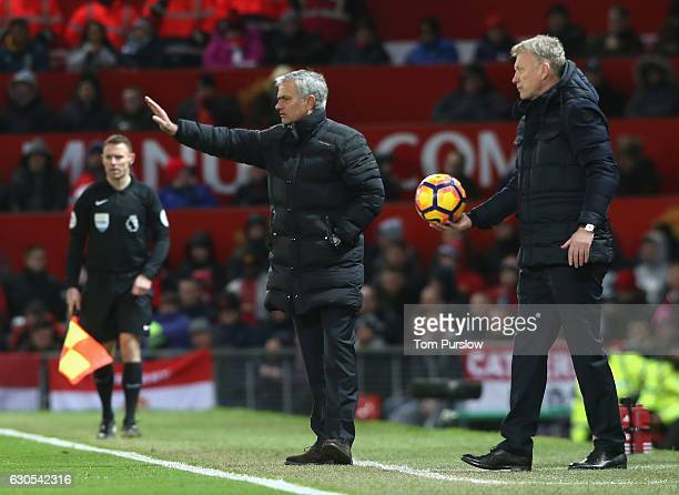 Manager Jose Mourinho of Manchester United and Manager David Moyes of Sunderland watch from the touchline during the Premier League match between...