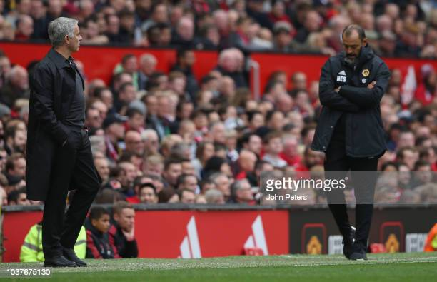 Manager Jose Mourinho of Manchester United and Manager Nuno Espirito Santo of Wolverhampton Wanderers watch from the dugout during the Premier League...