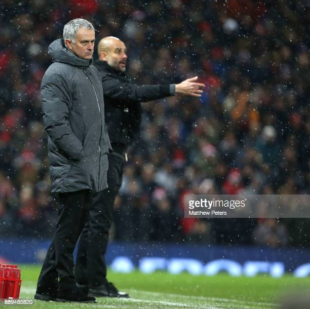 Manager Jose Mourinho of Manchester United and Manager Pep Guardiola of Manchester City watch from the touchline during the Premier League match...